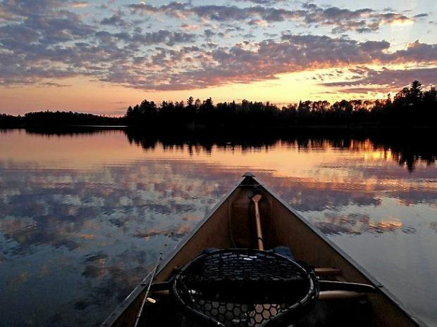 The sunset is reflected in calm waters of Lake Two in the Boundary Waters Canoe Area Wilderness Thursday, Aug. 13, 2015. (Pioneer Press: Dave Orrick)