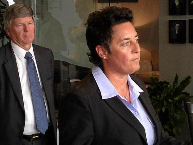 Former Minnesota-Duluth women's hockey coach Shannon Miller, right, speaks to reporters Monday, Sept. 28, 2015 in Eden Prairie. To her left Donald Chance Mark Jr., one of the attorneys in a gender discrimination lawsuit filed against the University of Minnesota Board of Regents Monday on behalf of Miller and former UMD coaches Jen Banford and Annette Wiles. (Pioneer Press: John Shipley)