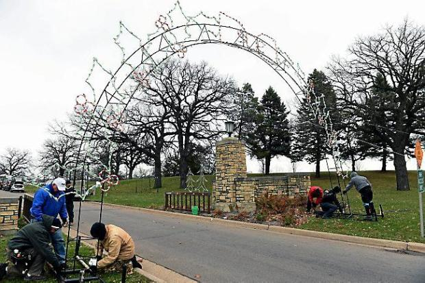 Volunteers assemble and erect an arch with lights over the roadway in St. Paul's Phalen Park, in preparation for the annual Holiday Lights in the Park display, on Thursday, November 19, 2015. More than 20,000 cars have visited Holiday Lights in the Park in each of the past seven seasons, making it the area's largest nightly holiday celebration. (Pioneer Press: Scott Takushi)