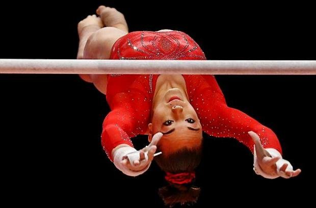 Maggie Nichols of the U.S. performs on the uneven bars during the women's team final competition at the World Artistic Gymnastics championships at the SSE Hydro Arena in Glasgow, Scotland, Tuesday, Oct. 27, 2015. (AP Photo/Matthias Schrader)