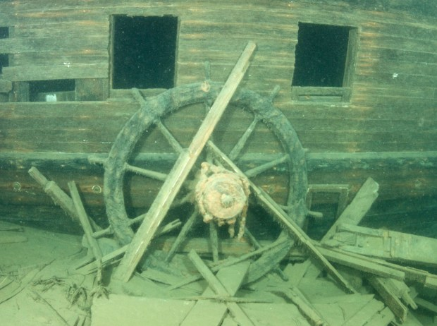 WRECK1103c6 -- The wheel of the J.S. Seaverns rests on the starboard side of the ship, amid what may be the remains of the pilothouse, where the ship sank in 1884 on Lake Superior near Michipicoten Harbor, Ontario. The wreck was discovered in July 2016. (Photo by Nick Lintgen)