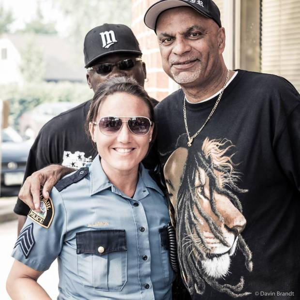 St. Paul Police Sgt. Amber Larson with Steve Randall, right, who is East Side coordinator for the St. Paul Ambassadors Initiative. Tim Simmons, the Ambassadors' Western District coordinator, is behind them. (Photo courtesy Davin Brandt)