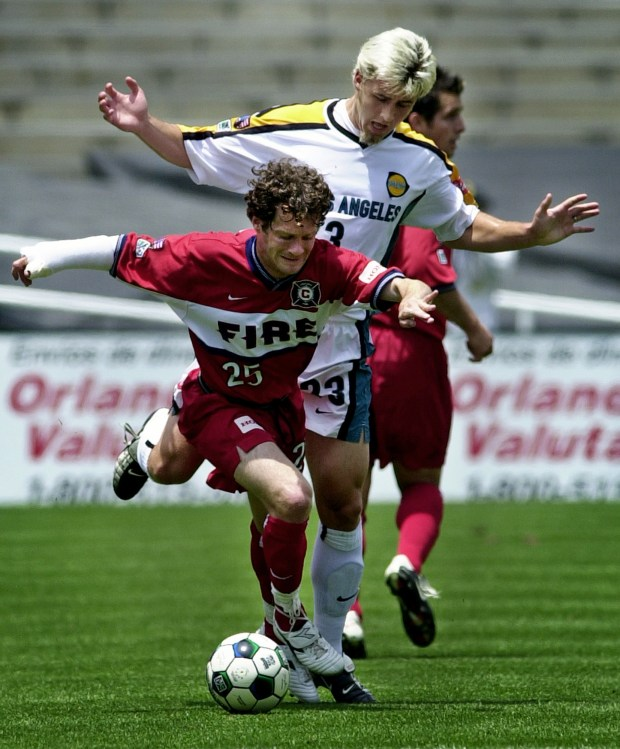 Chicago Fire forward Amos Magee (25) and Los Angeles Galaxy defender Danny Califf (23) battle for the ball in 2002 MLS game in Pasadena, Calif. (AP Photo/Reed Saxon)