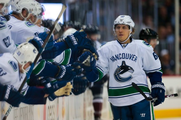 Teammates congratulate Vancouver Canucks center Markus Granlund (60) after he scored the game-winning goal during the shootout against the Colorado Avalanche in an NHL hockey game, Saturday, Nov. 26, 2016 in Denver. Vancouver won 3-2.(AP Photo/Joe Mahoney)