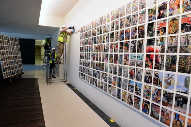 "Staff install Frank Big Bear's "" Walker Collage: Multiverse #10"" on a wall of Esker Grove, a new restaurant at the Wallker Art Center in Minneapolis, Thursday, November 10, 2016. (Pioneer Press: Scott Takushi)"