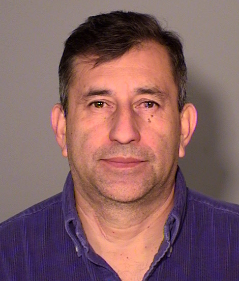 Fredy Roberto Escobar, 51, pretended to be a doctor, convinced female clients that they needed massages to treat their illnesses and then fondled them, according to criminal charges filed in Ramsey County district Court last October. He pleaded guilty to fourth degree criminal sexual conduct in May. (Photo Courtesy Ramsey County Sheriff)