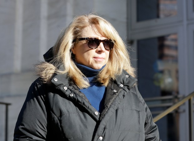 Diane Backis leaves the federal courthouse on Monday, Nov. 28, 2016, in Albany, N.Y. Backis, an accountant, has admitted stealing at least $3.1 million from Minnesota-based Cargill at the Port of Albany. (AP Photo/Mike Groll)