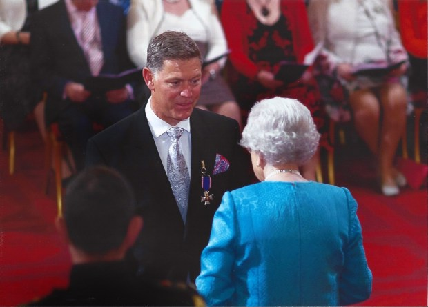"Queen Elizabeth II in 2013 made Richard Lett, who served for 32 years with London's Metropolitan Police as part of Scotland Yard's Royalty Protection Department, a member of the Royal Victorian Order for his ""loyal service to the United Kingdom and the Royal Family."" The photo was taken at Buckingham Palace. (ctsy Richard Lett)"