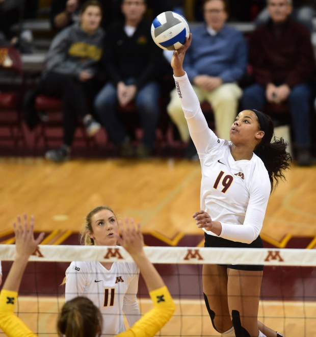 Minnesota's Alexis Hart returns the ball as the University of Minnesota Gophers Volleyball beat the Michigan Wolverines 25-23, 25-23, 23-25, 23-25 and 15-12, in Minneapolis, Sunday, Nov. 20, 2016. At left is Samantha Seliger-Swenson. (Pioneer Press: Scott Takushi)