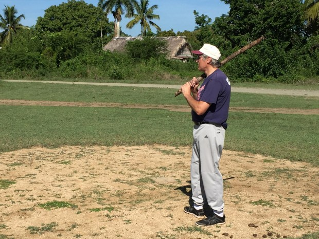 The Rev. Stan Mader of St. Ambrose of Woodbury Catholic Community waits for a pitch in a baseball game with youth from San Miguel de Cubitas church in Esmeralda, Cuba. The two parishes have become sister churches. (Courtesy of the Rev. Stan Mader)