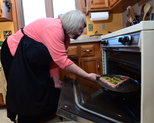 Carol Falkowski of Mahtomedi, who has published a cookbook on the many ways to decorate meatloaf, places a Christmas tree meatloaf in the oven, Dec. 15, 2016. (Pioneer Press: Scott Takushi)