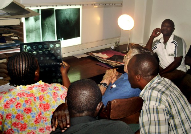 Professor Helmut Diefenthal, M.D. is pictured with students at the Kilimanjaro School of Radiology in 2010.