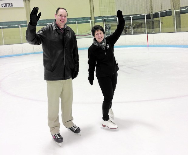 Jane Harrigan and Tom Zellmer wave from the ice during their adult intermediate class through Bielenberg Sports Center in Woodbury. (Courtesy of Brenda Walker)