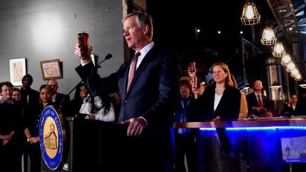 St. Paul Mayor Chris Coleman raises a glass of beer in a toast to St. Paul after he announces he will not run for mayor in 2017 at Lake Monster Brewery in St. Paul Thursday, Dec. 1, 2016. (Pioneer Press: Jean Pieri)