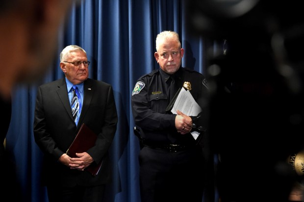 St. Anthony Mayor Jerry Faust and St. Anthony Police Chief Jon Mangseth listen to and COPS Office Director Ronald Davis at a press conference Thursday, Dec. 15, 2016, in Minneapolis where the Department of Justice, Office of Community Oriented Policing Services (COPS Office) announces the launch of an independent and comprehensive assessment of the Saint Anthony Police Department as part of its collaborative reform initiative. (Pioneer Press: Jean Pieri)