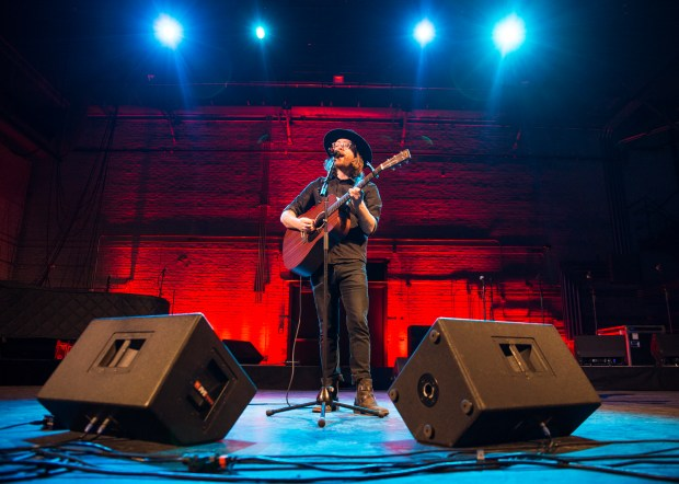 Surprise guest Jeremy Messersmith provided a musical performance as guests checked out the renovated space of the 100-year-old Palace Theatre venue in downtown St. Paul on Friday, Dec. 16, 2016. (Pioneer Press: Liam James Doyle)