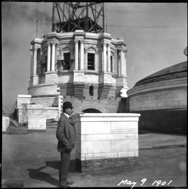 Capitol architect Cass Gilbert standing before the building's partially completed dome in May 1901. Photo courtesy of the Minnesota Historical Society.
