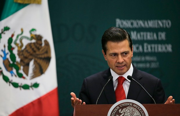 Mexico's President Enrique Pena Nieto speaks during a press conference at Los Pinos presidential residence in Mexico City, Monday, Jan. 23, 2017. Pena Nieto said Monday that Mexico's attitude towards the Donald Trump administration should not be aggressive or biased, but one of dialogue. (AP Photo/Marco Ugarte)