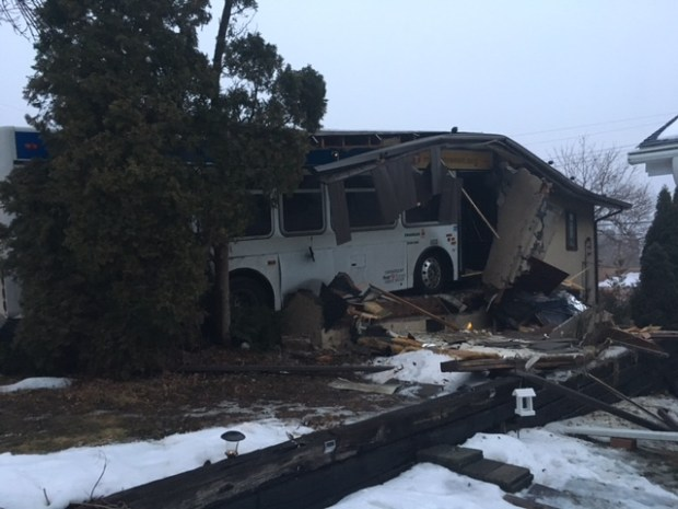 Two people were injured when an Anoka County Traveler bus crashed into a house in Columbia Heights on Friday, Jan. 20, 2017. (Courtesy: Columbia Heights Fire Department)