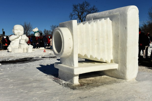 "At right is ""Focused on a Cure For MS"" by Kurtis Klett, Keith Klett and Mike Leider, at left is ""Playtime"" by Bill Wegwerth, Dan Ross and Weston Johnson which won the Artist's Choice and Vulcans' Choice award a the Minnesota State Snow Sculpting Competition. (Pioneer Press: Scott Takushi)"
