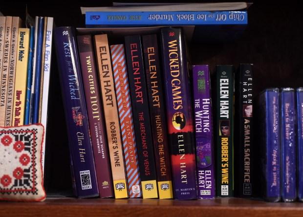 Some of mystery writer Ellen Hart's 30-plus books at her home in Eden Prairie, Dec. 21, 2016. (Pioneer Press: Scott Takushi)