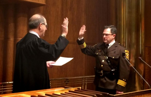 Ramsey County Chief Judge John Guthmann, left, administers the oath of office to Jack Serier on Tuesday, Jan. 10, 2017, just after the Ramsey County board unanimously voted to appoint him sheriff. (Pioneer Press: Mara H. Gottfried)