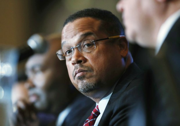 FILE - In this Dec. 2, 2016 file photo, U.S. Rep. Keith Ellison, D-Minn., listens during a forum on the future of the Democratic Party, in Denver. Ellison, who is currently running to be the next chair of the Democratic National Committee, announced Monday, Jan. 16, 2017, he is boycotting Donald Trump's presidential inauguration on Friday. (AP Photo/David Zalubowski, File)