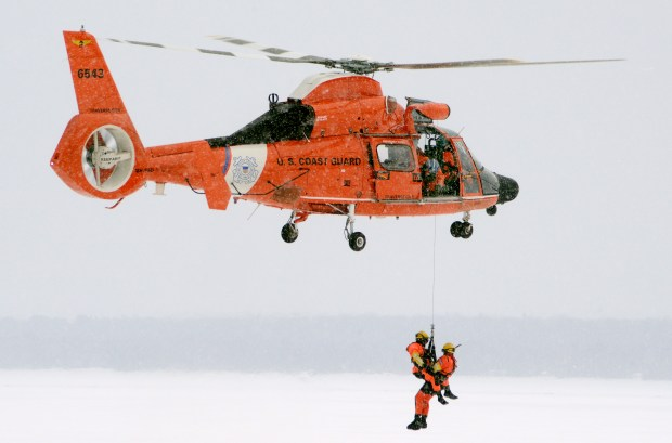 022317.N.DNT.HelicoptersC1 -- A Dolphin helicopter crew from U.S. Coast Guard Air Station Traverse City, Mich., participates in the Twin Endeavor mass ice-rescue exercise in Brimley, Mich., March 5, 2016. The Coast Guard, along with 26 other agencies, participated in the Twin Endeavor plane crash exercise on Waiska Bay. (U.S. Coast Guard photo by Petty Officer 3rd Class Joel Altman)