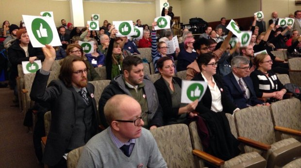 Spectators, warned to keep quiet, use thumbs-up signs to express their opinions during a House Job Growth Committee hearing Thursday, Feb. 2, 2017, on a bill that would strip Minnesota cities of the ability to impose wage and benefit mandates in excess of state law. (Pioneer Press: Frederick Melo)