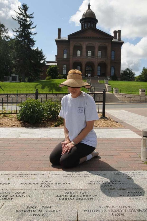 Joanne Adcock sits near pavers installed at the Stillwater Veterans Memorial. (Pioneer Press file photo: Ginger Pinson)