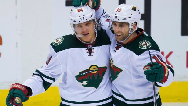 Minnesota Wild's Mikael Granlund, left, of Finland, and Jason Zucker celebrate Granlund's third goal against the Vancouver Canucks, during the third period of an NHL hockey game Saturday, Feb. 4, 2017, in Vancouver, British Columbia. (Darry Dyck/The Canadian Press via AP)