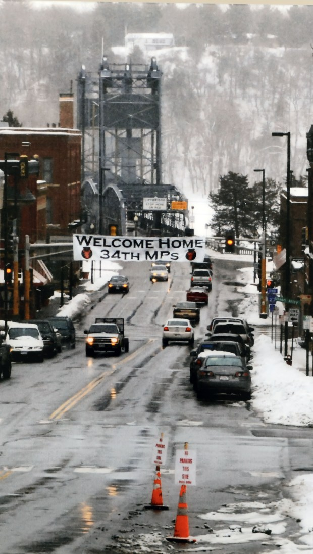 A panel depicting Stillwater's 34th MP Company returning home after its tour in Iraq, January 2010, is one of 33 photo panels depicting the National Guard's history in Stillwater from 1840 to the present, to be mounted on the walls of the new Stillwater Armory, Feb. 27, 2017.