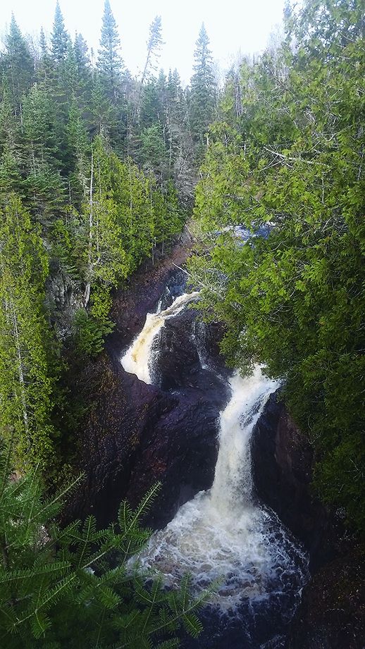 The Brule River splits in two at Devil's Kettle Falls in Judge C.R. Magney State Park near Grand Marais, Minn. in an undated courtesy photo. The water cascading into the cavernous kettle, left, that famously ÒdisappearsÓ into a hole actually soon re-enters the river from underground, according to new research. In fall 2016, hydrologists from the Minnesota Department of Natural Resources found nearly identical volumes of water flowing both above the DevilÕs Kettle waterfall and below it. Photo courtesy of the Minnesota Department of Natural Resources.