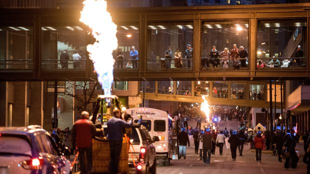 Crowds lines the streets of downtown St. Paul Saturday, Feb. 4, 2017, to watch the flaring of torches as part of the annual Winter Carnival Vulcan Victory Torchlight Parade. (Pioneer Press: Andy Rathbun)