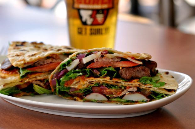 Steak busta & Surly beer at D'Amico & Sons. (Courtesy photo)