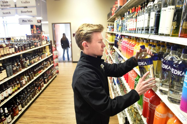 Max Pelarske, a sales associate at Lakeville Liquors, stocks vodka on Thursday, Feb. 16, 2017. The liquor store has been the largest municipal liquor operation in the state since 2002. (Pioneer Press: Jean Pieri)