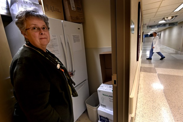Ellen Johnson shows the locked refrigerator in a secure storage room around the corner from the Sexual Assault Nurse Examiner (SANE) room at Regions Hospital on Wednesday, Feb. 15, 2017. Sexual assault evidence collection kits are kept inside the refrigerator. (Pioneer Press: Jean Pieri)