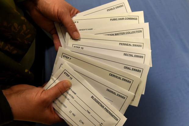 Ellen Johnson shows the envelopes used for collecting swab sambles for the sexual assault examination kit at Regions Hospital on Wednesday, Feb. 15, 2017. (Pioneer Press: Jean Pieri)