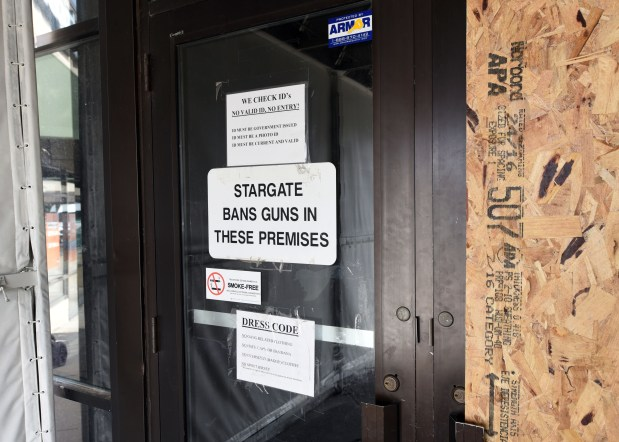 One door of Stargate nightclub in Maplewood is boarded up after being shot out and the other has signs banning guns and certain clothing on Thursday, Feb. 23, 2017. The shooting happened Saturday. One man who was shot inside the nightclub alleges that security procedures weren't consistently being followed. (Pioneer Press: Dave Orrick)