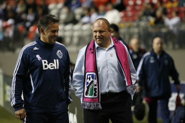 VANCOUVER, CANADA - OCTOBER 6: Tom Soehn (R), head coach of the Vancouver Whitecaps, walks to the team bench with Ed Georgica of the Vancouver Whitecaps FC before their matchup against the Real Salt Lake at the Bell Pitch at BC Place October 6, 2011 in Vancouver, British Columbia, Canada. (Photo by Kim Stallknecht/Getty Images)