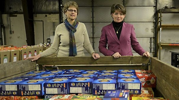 Century College's Judy Lykins, left, and White Bear Emergency Food Shelf's Alison Schram stand at a trailer holding the first load of provisions to be served at the new food pantry on campus. The site was set to provide free, single-serving meals to needy students and was being organized by the White Bear Area Emergency Food Shelf. (Pioneer Press archives: Chris Polydoroff)