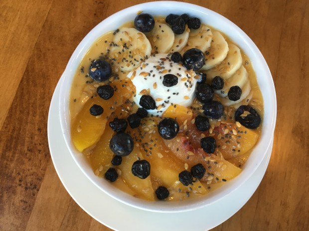 A peaches and cream smoothie bowl at Cafe Astoria on Grand Avenue and West Seventh Street in St. Paul. (Pioneer Press: Jess Fleming)