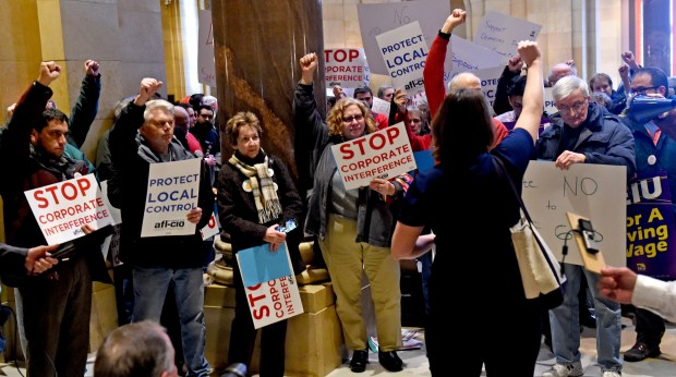 Protestors of the preemption bill, that prevents cities from implementing their own sick pay and minimum wage rules, had a rally in front of the House chambers at the State Capitol on Thursday, March 2, 2017. (Pioneer Press: Jean Pieri)
