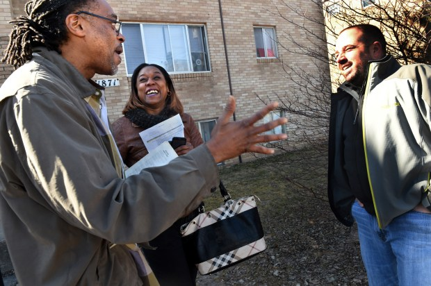 Frank Amal Baker, left, joined by his fiancee, Tasha Miller, talks with former St. Paul Police officer Tony Spencer, right, outside his St. Paul apartment on Wednesday, March 22, 2017. Spencer retired last October after 20 years in law enforcement, including a police call last June that involved Baker and played a role in Spencer's decision to leave the force. (Jean Pieri / Pioneer Press)