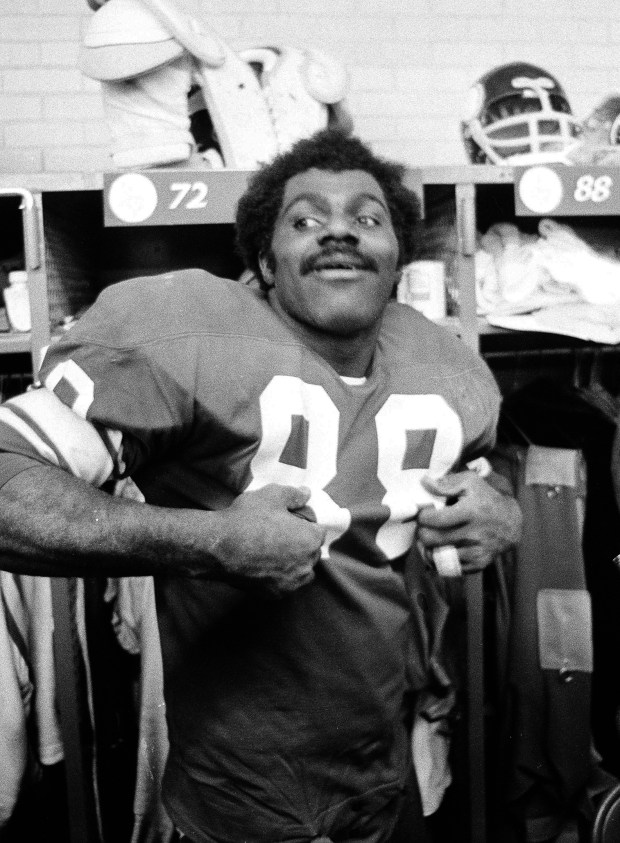 Minnesota Vikings defensive tackle Alan Page is a happy man in the locker room in Minneapolis after Minnesota beat the Detroit Lions to win the National Football Conference Central Division title, Dec. 11, 1971. (AP Photo)