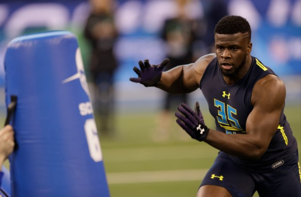 Northwestern defensive end Ifeadi Odenigbo runs a drill at the NFL football scouting combine Sunday, March 5, 2017, in Indianapolis. (AP Photo/David J. Phillip)