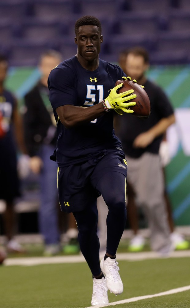 North Carolina State defensive back Jack Tocho runs a drill at the NFL football scouting combine Monday, March 6, 2017, in Indianapolis. (AP Photo/David J. Phillip)