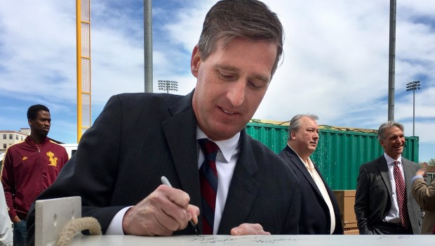 University of Minnesota athletics director Mark Coyle signs the final structural beam for the University of Minnesota's Athletes Village, a $166 million project scheduled to open in about nine months in Minneapolis, on Friday, April 28, 2017. The beam is part of an indoor practice facility for the football team and was raised at a ceremony attended by donors, players and members of the athletics department. (Dane Mizutani / Pioneer Press)