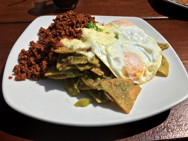 April 2017 photo of Chilaquiles -- Sonora Grill on Lake Street -- chilaquiles with house-made turkey chorizo. Chilaquiles, a Mexican breakfast staple is basically tortilla chips smothered in sauce and topped with any number of savory items -- meat, cheese, eggs, sour cream, cilantro, the possibilities are endless. The dish, which is different in every home or restaurant, is a great use for slightly past-their-prime tortilla chips. These days, chilaquiles are hot -- they're showing up on brunch menus at mainstream restaurants, too. We sampled towering plates of tortilla chips and sauce all over town, and here are our favorites. A few of these are available all day, because chilaquiles, like pancakes, are good anytime, but the majority are breakfast or brunch only. (Jess Fleming / Pioneer Press)