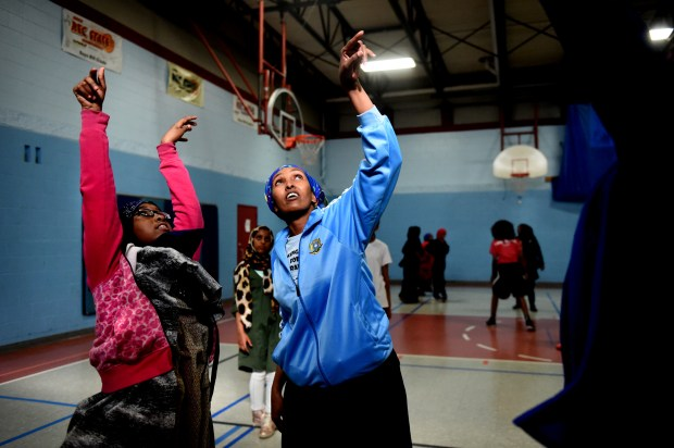 Fartun Osman coaches basketball teams at West Minnehaha Recreation Center in St. Paul on Wednesday, April 5, 2017. Fartun, a physical education teacher at Higher Ground Academy charter school in St. Paul was supposed to coach the Somali national women's basketball team in a tournament last month in Egypt. It would have been the country's first such team in 26 years, but most of the team got stuck in Dubai because of visa problems. Jean Pieri / Pioneer Press
